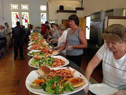 volunteers prepare to serve food