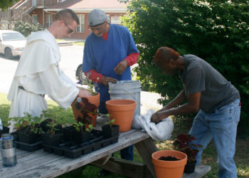 Br. Bernard Knapke, along with Tranquil House and S.R.O. residents planted flowers around campus.