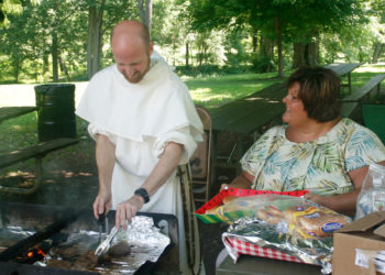Br. Brendan Baran and Renée Bailey, Program Manager at Roberts Hall, during a client picnic.
