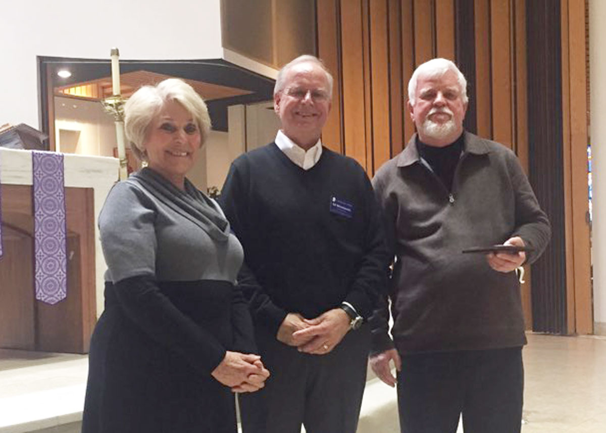 Donna Young and Ed Wnorowski (left) John Kolb from the St. Athanasius Conference (right) received the Ozanam Medallion award.